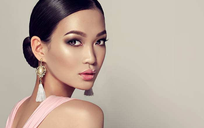 Young, gorgeous asian woman in a smoky eyes style make up